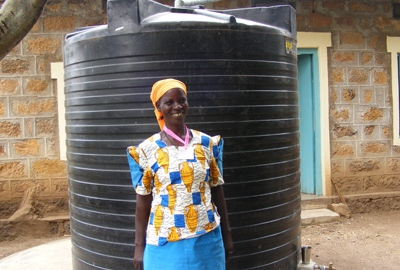 woman in front of water tank